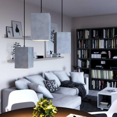 Lámpara colgante hecha en Italia con cable textil, pantalla Cubo en acabados de cemento y metal